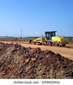Grader adjust elevation level soil for construction site