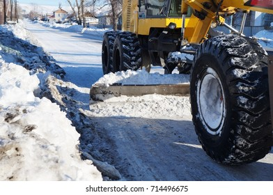 The grader cleans the street!
