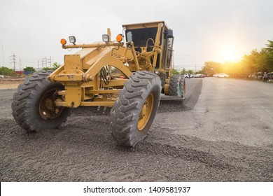 Grader leveled the ground on construction of the road.