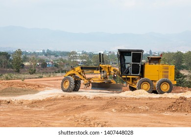 grader tractor on working on construction site