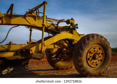 Graders after use are completed on the construction site.Heavy-duty graders in the road construction industryDiesel power engine, road construction equipment.