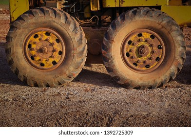 Graders wheel ,Graders after use are completed on the construction site.Heavy-duty graders in the road construction industry Diesel power engine, road construction -image