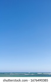 Gradient clear blue sky with sea horizon