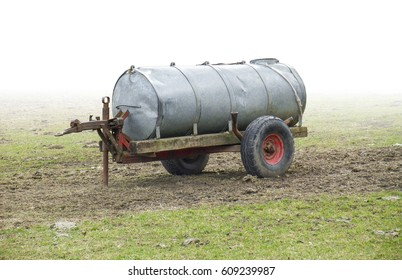 gradient isolated rundown liquid manure spreader on a meadow