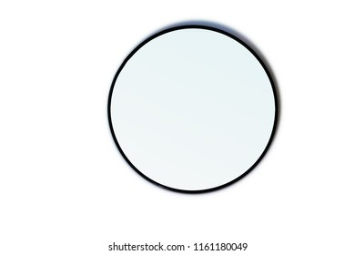 A gradient mirror laying on a white table.