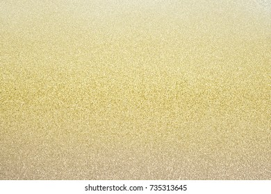 Gradient of shiny pastel gold brown glitter texture christmas abstract background .