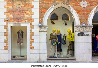 GRADO, Italy - April 13, 2018: Windows of a clothing store in a historic building in the small coastal town and seaside resort of Grado