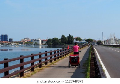 Grado, Italy. June 29 2018:  The arrival of the long and fascinating international cycling route called Alpe Adria Cycle , which starts from the Salzburg Alps to reach the Adriatic sea in Friuli.