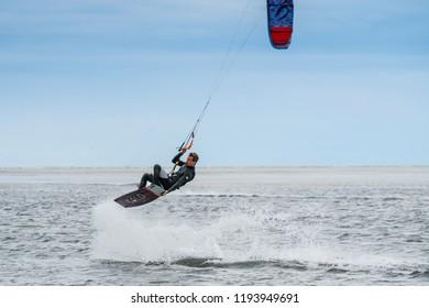 Grado, Italy, September 2018. A man doing kitesurf at the sea