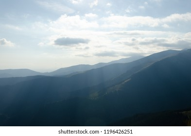 The gradual fading out of dark blue colour of the mountains into the blue of the sky Mountains panorama landscape with blue and dark blue layers of mountains. The tops of the mountains at horizon.