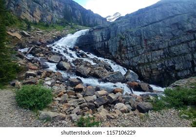 gradual slope waterfall in rocky mountains