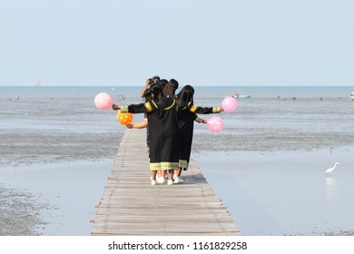 Graduate, congratulations, education, people, concept - graduates with seacoast scene