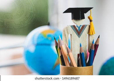 Graduate or Education knowledge learning study abroad concept : Graduation cap with blur america earth globe, radar background, alternative studying distant for learn. Back to School and successful