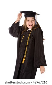 A graduate with an excited expression on her face with fist raised in the air.