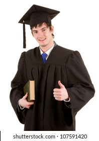 A graduate holding a book by his side, isolated on white