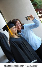 Graduate and mom taking photo together