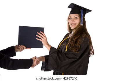 A graduate receiving her diploma with a hand shake.