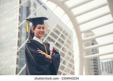 Graduate Student and Success Education in University Concept. Happy Asian student woman graduate diploma and MBA degree in asian college.
