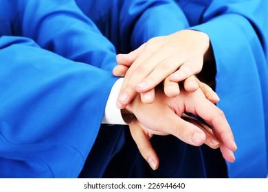Graduate students hands, close up