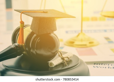 Graduate study abroad program concept : Graduation cap on a gavel, balance scale of justice behind, a certificate. Graduate study abroad program is a program that accept students from foreign country