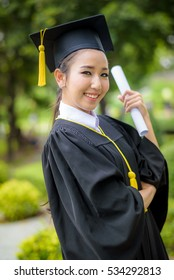 Graduate woman students wearing graduation hat and gown