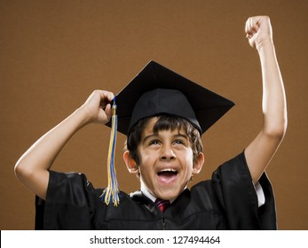 Graduated boy with mortarboard cheering