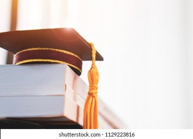 Graduated or Graduation university study abroad international Conceptual, Congratulations to graduates hat on textbooks stack in classroom. Studies lead to success in Goal life. Back to School