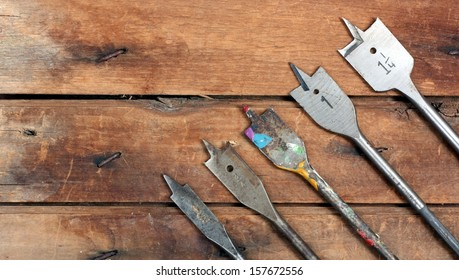 Graduated Size Spade Drill Bits on a Wood Workbench