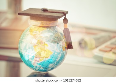 Graduated study abroad international Conceptual, Graduation hat on top Earth globe model map with Radar background. Congratulations to graduates, Studies lead to success in world wide. Back to School