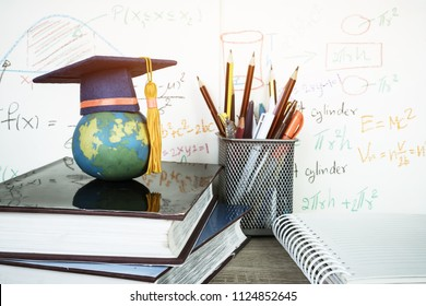 Graduated study abroad international Conceptual, Graduation hat on  Earth globe model map with formula arithmetic. Congratulations to graduates, Studies lead to success in world wide. Back to Schoo