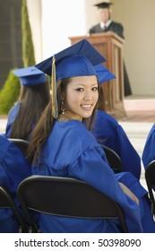 Graduates listening to speaker outside