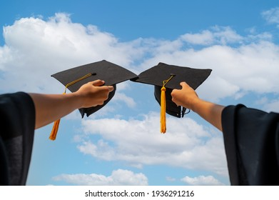 graduates student Graduation caps thrown in the Air Blue sky