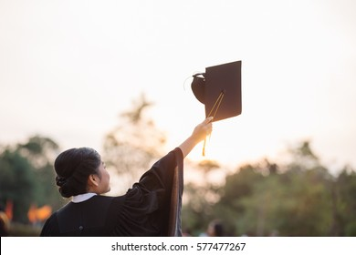 Graduates of the University,Of graduates holding hats handed to the sky, Education concept.