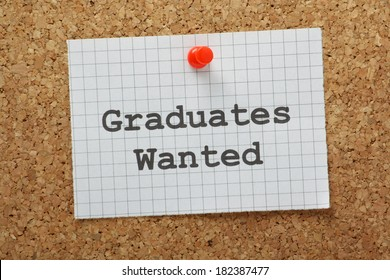 Graduates Wanted typed on a piece of graph paper and pinned to a cork notice board