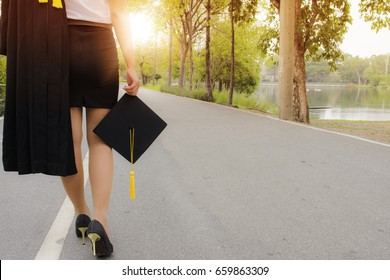The graduating girl is walking along the road of life.