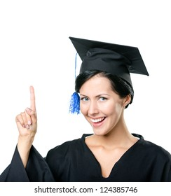 Graduating student in black academic gown and cap making the attention gesture, isolated on a white