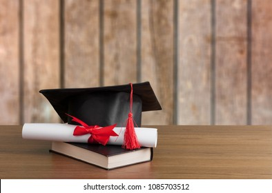 Graduation black hat on desk