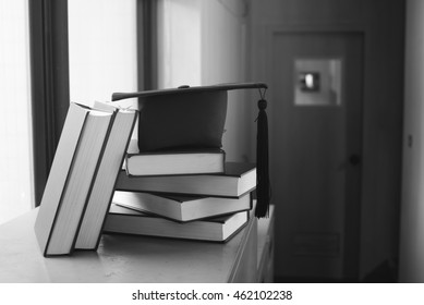 graduation cap and Books step ,Education concept on black and white image