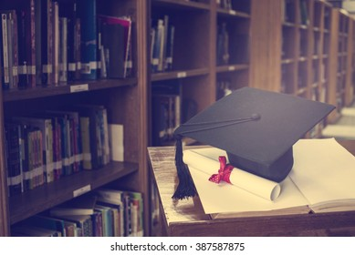 graduation cap and Books step in Library room,Education concept
