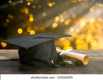 graduation cap, hat with degree paper on wood table, abstract light background Empty ready for your product display or montage.