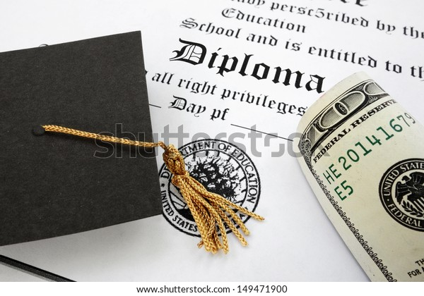graduation cap and money on a diploma