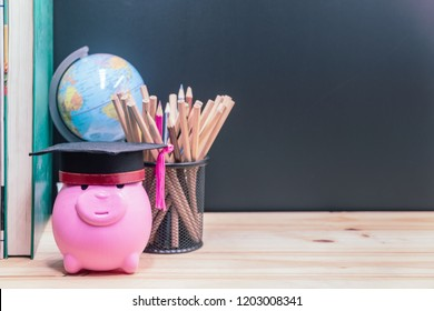 Graduation cap with piggy bank with books And pencil.