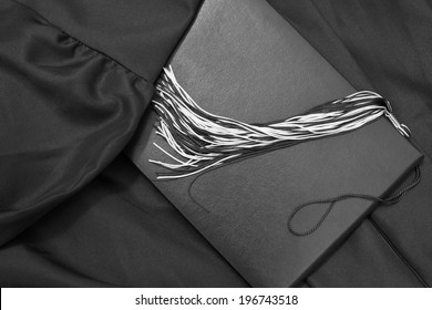 Graduation Day. A gown, tassel, and diploma and laid out ready for graduation day.