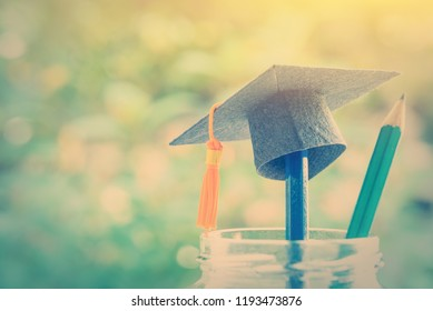 Graduation day, graduate study abroad program and back to school concept : Black graduation cap or mortarboard on a tip of a pencil, depict a success in university education, bachelor or master degree