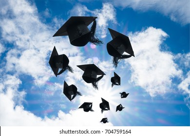 Graduation day, Images of graduation Caps or hat throwing in the air with sunshine day on blue sky background, Happiness feeling, Commencement day, Congratulation, Ceremony.