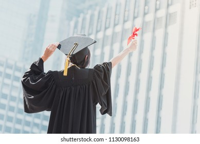 Graduation day, Images of graduate is celebrating graduation put hand up, a certificate and a hat in hand, Happiness feeling, Commencement day, CongratulationFinishing school and find a job.