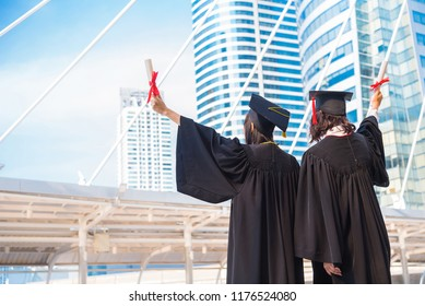 Graduation day, Images of graduate is celebrating graduation put hand up, a certificate and a hat in hand, Happiness feeling, Commencement day, Congratulation