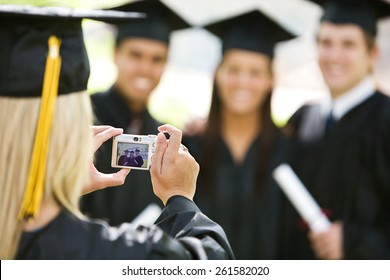 Graduation: Girl Takes Photo of Friends After Ceremony