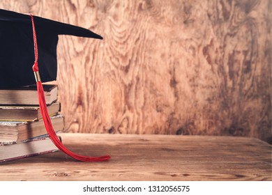 Graduation hat with books on table. Education concept