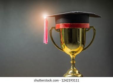 graduation hat with golden trophy